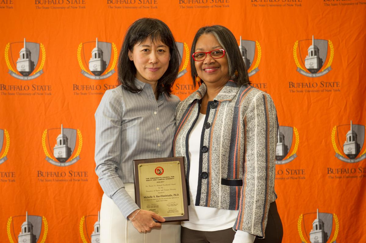 Michelle Bae-Dimitriadis with President Conway-Turner