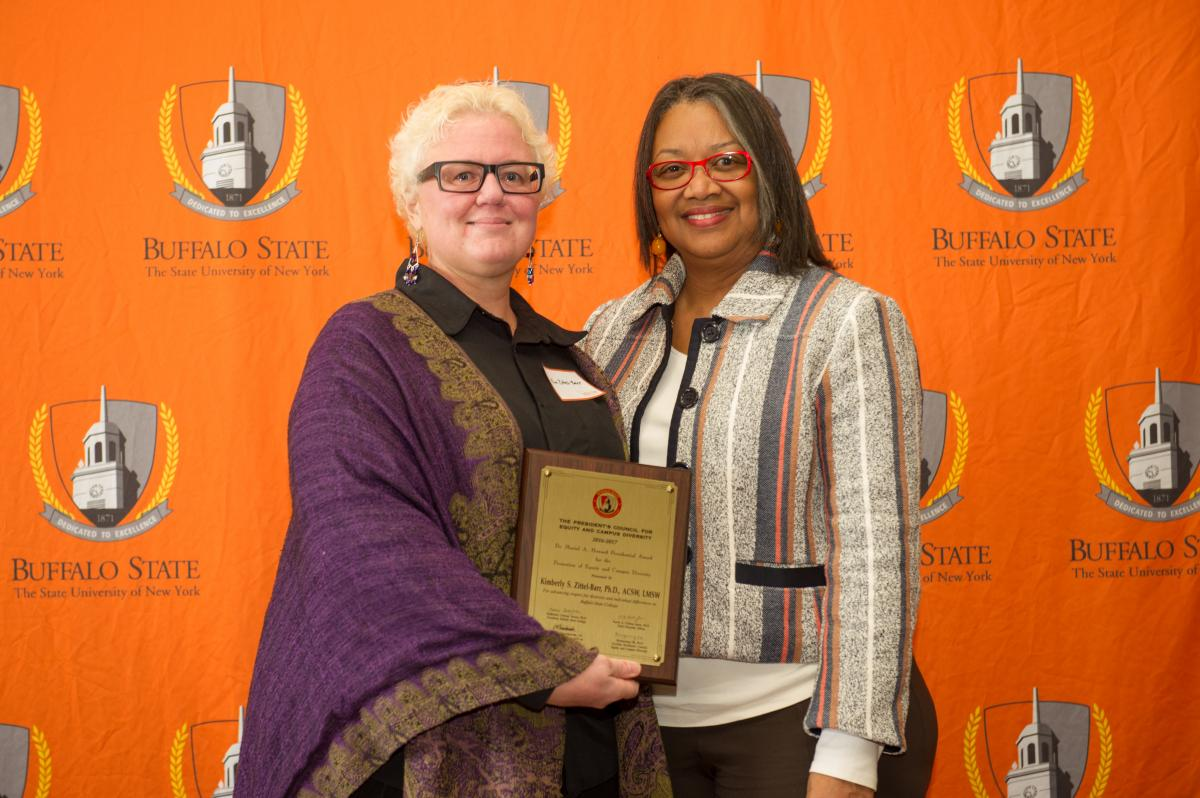 Recipient Kimberly Zittel-Barr, Ph.D. and President Conway-Turner